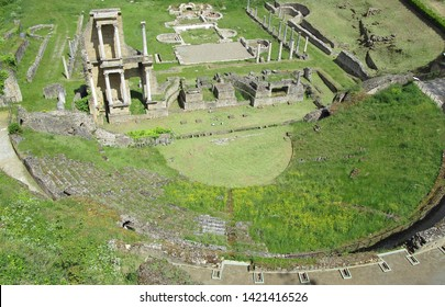 Volterra, Tuscany, Italy, May 23, 2019.  Roman ruins / amphitheatre, shot looking north from high on the city walls.  Volterra, Tuscany, Italy, May 23, 2019