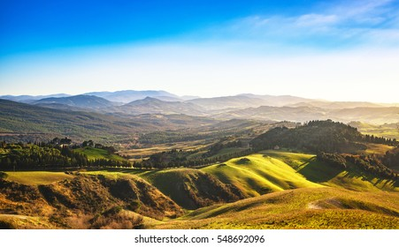 Volterra winter panorama, rolling hills and green fields on sunset. Tuscany Italy, Europe