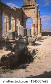 VOLUBILIS, MOROCCO - OCT 15, 2000 - Tourists erxplore the ruins  in the abandoned city of Volubilis, Morocco