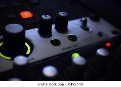 Volume control on rackmount audio device - focus on Headphones jack.