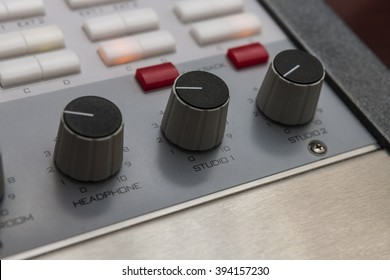 Volume dials on an audio mixing board