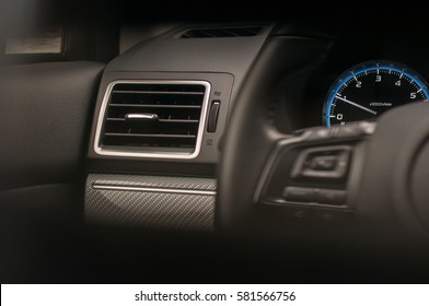 Volume level control and mobile phone controls on the steering wheel. Air vent, odometer and interior trims.