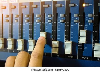 volume up,mixer music in studio,professional sound engineer.