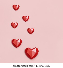 Volumetric paper hearts red colored. Greeting card or invitation for wedding card or Valentines Day. Pastel colors.