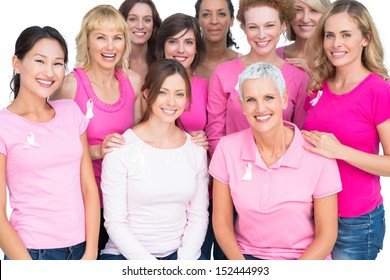 Voluntary pretty women posing and wearing pink for breast cancer on white background