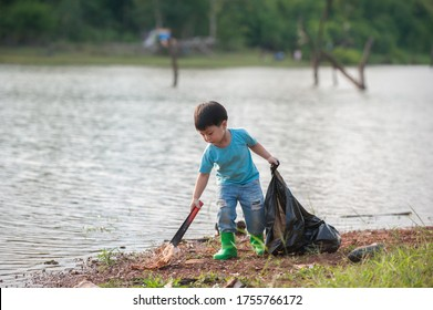 Volunteer children collecting rubbish on the river