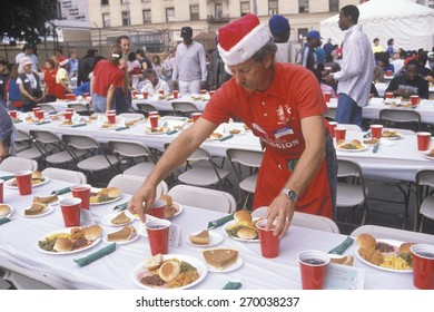 Volunteer at Christmas dinner for the homeless, Los Angeles, California
