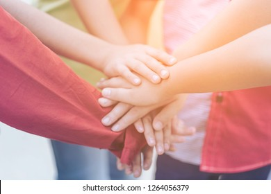 Volunteer community Youth or Pupil or Success Teamwork Together concept. POV. point of view. pre-teen friends  with stack of hands showing unity and teamwork. children putting their hands together.