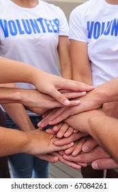 volunteer group hands together showing unity