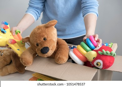 volunteer holding donation box with old toys.