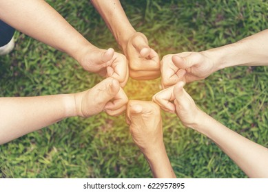 Volunteer Leader effective is key to success. Team Charity group of people giving thump up hands together. Volunteer Spirit Team Members.  Volunteer Leader Concept.
