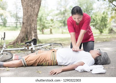volunteer woman use hand pump on chest of Asian patient man, unconscious patient treatment, cardiopulmonary resuscitation, cpr process, heart attack, Acute myocardial infarction