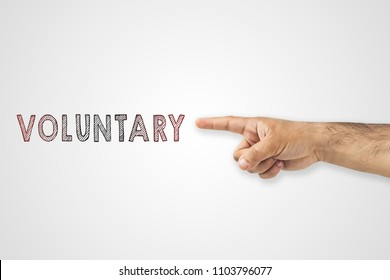 volunteering concept. Hand pointing to voluntary inscription on white