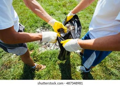 Volunteers cleaning up garbage together