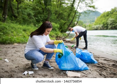 Volunteers cleaning plastic at river beach