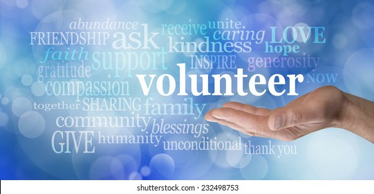 Volunteers needed hand gesture on blue bokeh  -  Male hand palm up with the word 'volunteer' floating above surrounded by relevant words on a blue bokeh background