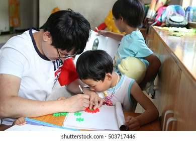 Volunteers and on June 6, 2015, xi 'an in shaanxi province needs of children play games together, chatting, painting, birthday, love, to guide the children healthy and happy growth.