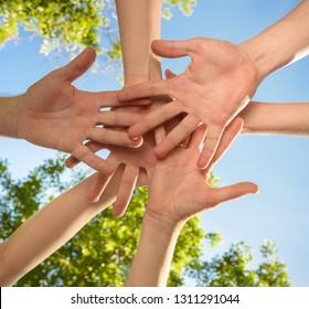 volunteers people hands together outdoors