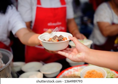 Volunteers Share Food to the Poor to Relieve Hunger : Charity concept : Donate food to hungry people : Concept of poverty and hunger