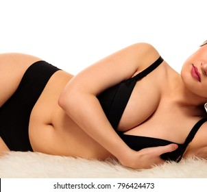 Voluptuous busty woman posing on a white background, isolated
