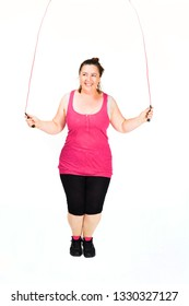 Voluptuous woman is skipping the rope,isolated on white.