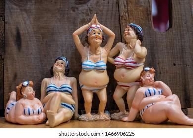 Voluptuous women in bathing suits souvenirs arranged on a shelf of gift store.  Broadway boardwalk, Myrtle Beach, South Carolina, USA. July 23 2019