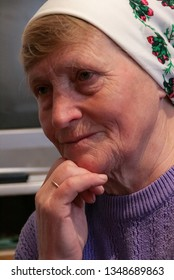 Volycia, Volyn / Ukraine - March 25 2009: Unknown old Ukrainian woman with kerchief at home