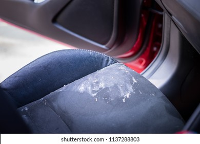 Vomit or puke left over in the car at car seat and wheel.