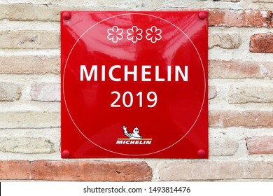 Vonnas, France - April 5, 2019: Michelin restaurant 3 stars symbol on a wall. Michelin guides are a series of guide books published by the French company Michelin for more than a century