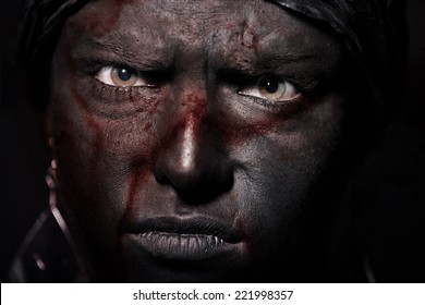 Voodoo with bloody black skin. Close-up portrait