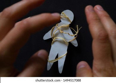 Voodoo Doll on black background. Curse concept