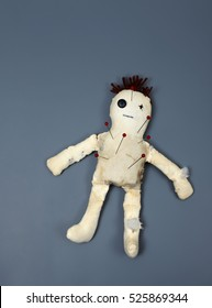 Voodoo Doll with Pins in it