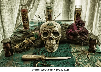 Voodoo Skull Ritual Evil. Voodoo related objects on a table including a skull, a knife and candles.