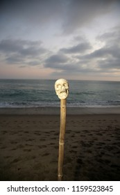 Voodoo Skull. Scary Halloween Skull on a Bamboo Pole at the beach. Voodoo Sacrifice at the beach at Sunset.
