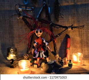 Voodoo and witchery table with symbols and voodoo doll