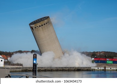 Vordingborg Denmark - April 6. 2018: Demolition of a silo ends badly as the silo falls in the wrong direction, silo falling in wrong direction