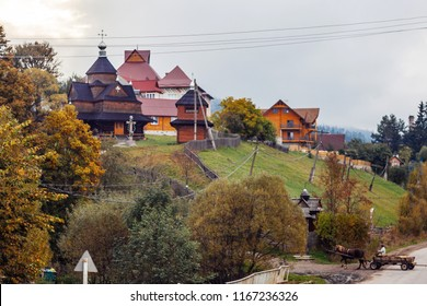 VOROHTA, UKRAINE - OCTOBER 20, 2015: People in formal attire go out of the village Orthodox church on October 20, 2015. Vorohta village, Ukraine
