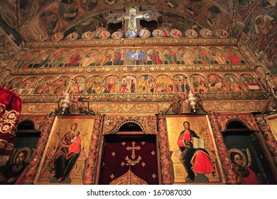 VORONET - OCTOBER 01: The most famous and stunning of the painted monasteries in Romania is Voronet founded in 1487 by Stephen the Great . The famous altar seen on October 1, 2013 in Voronet, Romania.