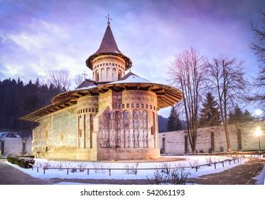 Voronet orthodox painted church monastery in winter season, Moldavia, Bucovina, Romania
