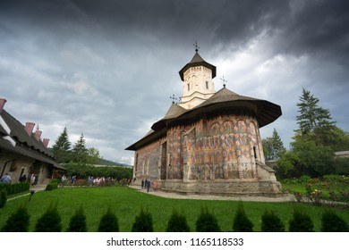 Voronet, Romania. August 15, 2018. View of painted church in medieval monastery in romanian village