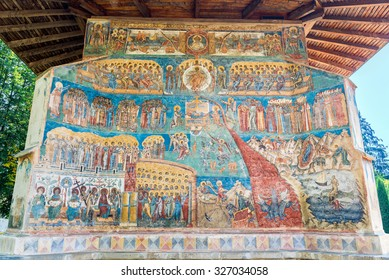 """VORONET, ROMANIA- AUGUST 2015: Last Judgment, Final Judgment, Day of Judgment, or The Day of the Lord fresco on western wall of Voronet Monastery, considered by many the """"Sistine Chapel of the East"""""""