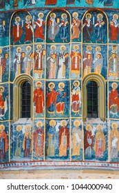 Voronet, Romania, July 06, 2015: Orthodox church exterior with painted murals, painted church in Romania