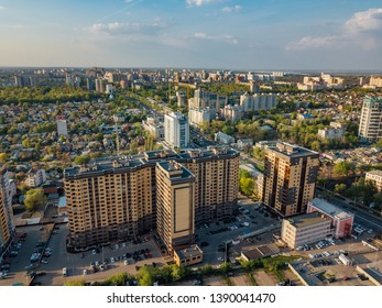 Voronezh city in summer day. residential building with parking lot.