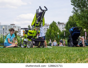 "Voronezh, Russia - August 12, 2018: Moms with children rest on the lawn in the park ""Arena"", the city of Voronezh"