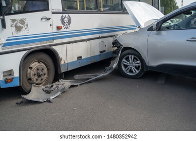 Voronezh, Russia August 16, 2019: A terrible accident on the street. A damaged car after a collision on the bus in the city. The concept of careless driving.