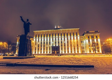 VORONEZH, RUSSIA - Circa December 2018: Lenin Square, Voronezh downtown. Night cityscape. The building of the Government of Voronezh region and Lenin monument