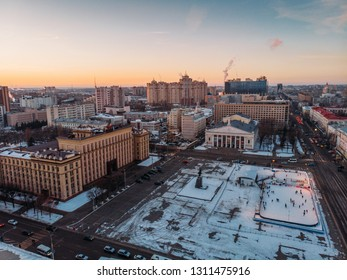Voronezh, Russia - Circa February 2019: Aerial view Voronezh city midtown, Lenin Square, Building of Government of Voronezh and theatre in winter sunset