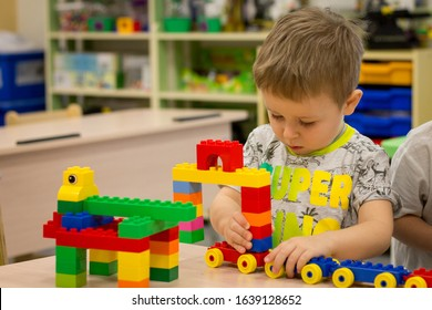 Voronezh, Russia - January 2020: Child playing with colorful toy blocks. Little boy building tower of block toys in a robotics class. Educational toys and games for preschool and kindergarten children