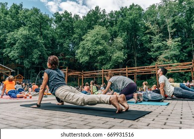 VORONEZH, RUSSIA - JUNE 18, 2017: Group of people are engaged in yoga in the Dynamo park on the International Yoga Day in Voronezh, Russia