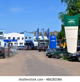 VORONEZH, RUSSIA - MAY 13, 2013: Entrance to the car shop, which sells cars UAZ and LADA. This is a very popular car brands in Russia
